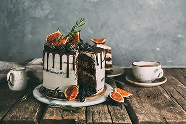 Chocolate cake featuring figs and blackberries