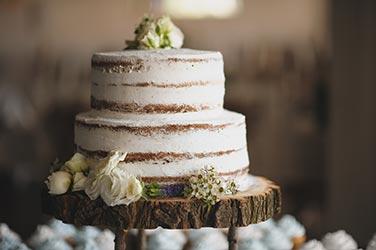 Wedding cake on wooden base
