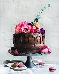 Chocolate wedding cake with flowers and macarons