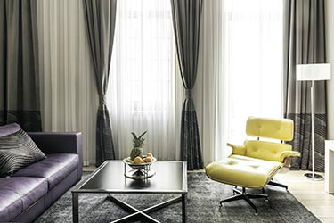 Bespoke full length curtain sets, both muslin and custom material matching furniture