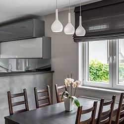 Custom fabric Roman blinds in modern dining room