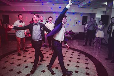 Wedding guests dancing and having fun to DJ music