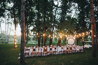 Evening, outdoor, festive gathering at banquet table