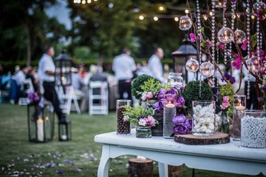 Bespoke table arrangements for rustic evening event
