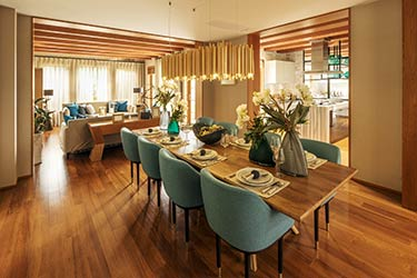 Chic, retro lounge and dining room featuring modern hardwood flooring