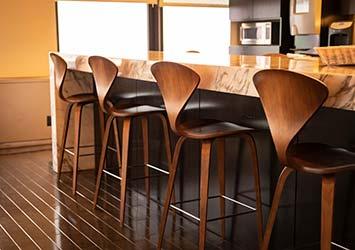 Bespoke wooden bench chairs in elegant kitchen