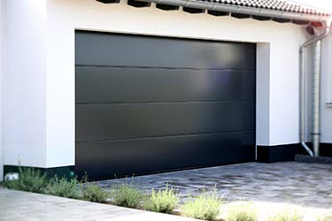 Ultra modern black minimalist garage door on new home