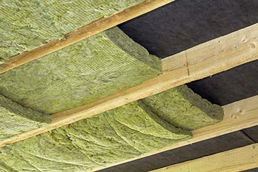 Eco friendly insulation installed neatly in wooden ceiling