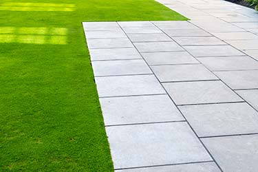 Green lawn and pavers