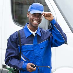 Smiling pest control technician in uniform