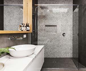 Beautiful tesselated tiling in modern shower of minimalist bathroom