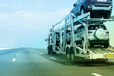 Car shipment truck safely transports multiple cars cross country