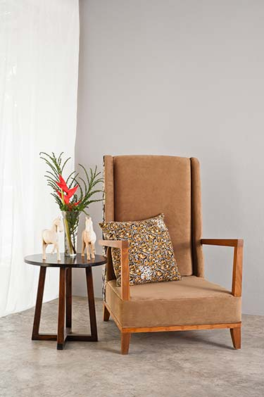Unique statement chair upholstered in rich brown suede material, backed with fashionable patterned print